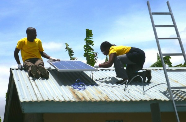 Mobisol Technicans installing PV Panel